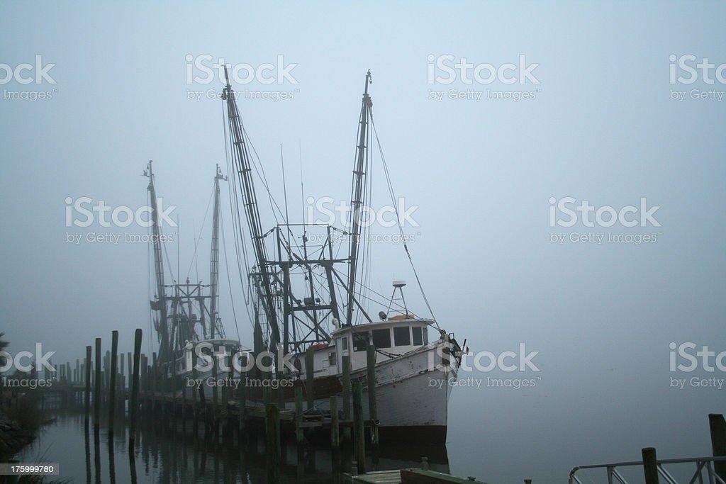 Shrimp Boat Docked in the Fog stock photo