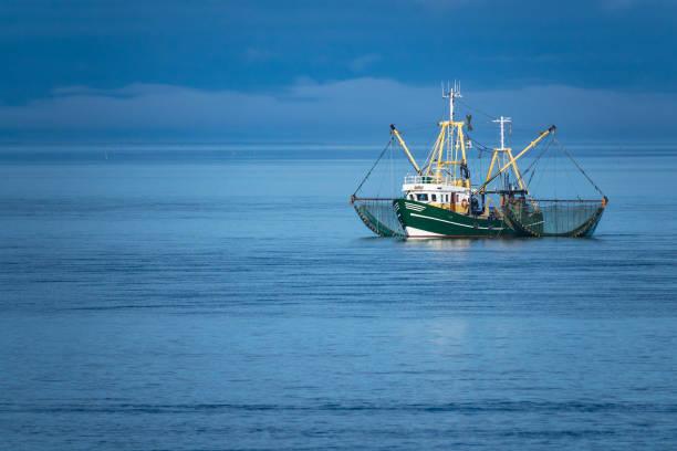 Shrimp boat on the North Sea stock photo