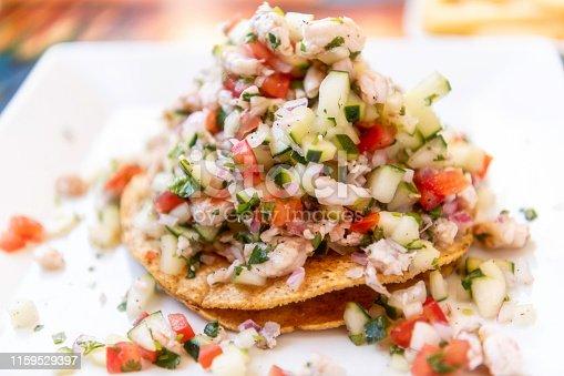 Mexican Shrimp Ceviche Tostada (Tostada de Ceviche de Camaron) in a restaurant table