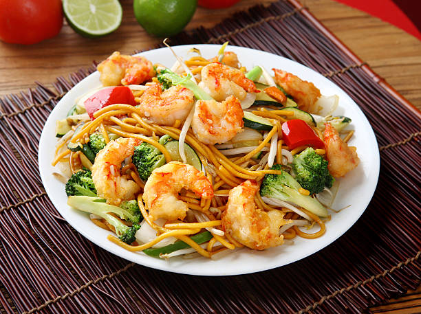 shrimp chow mein - chinese food stock photos and pictures