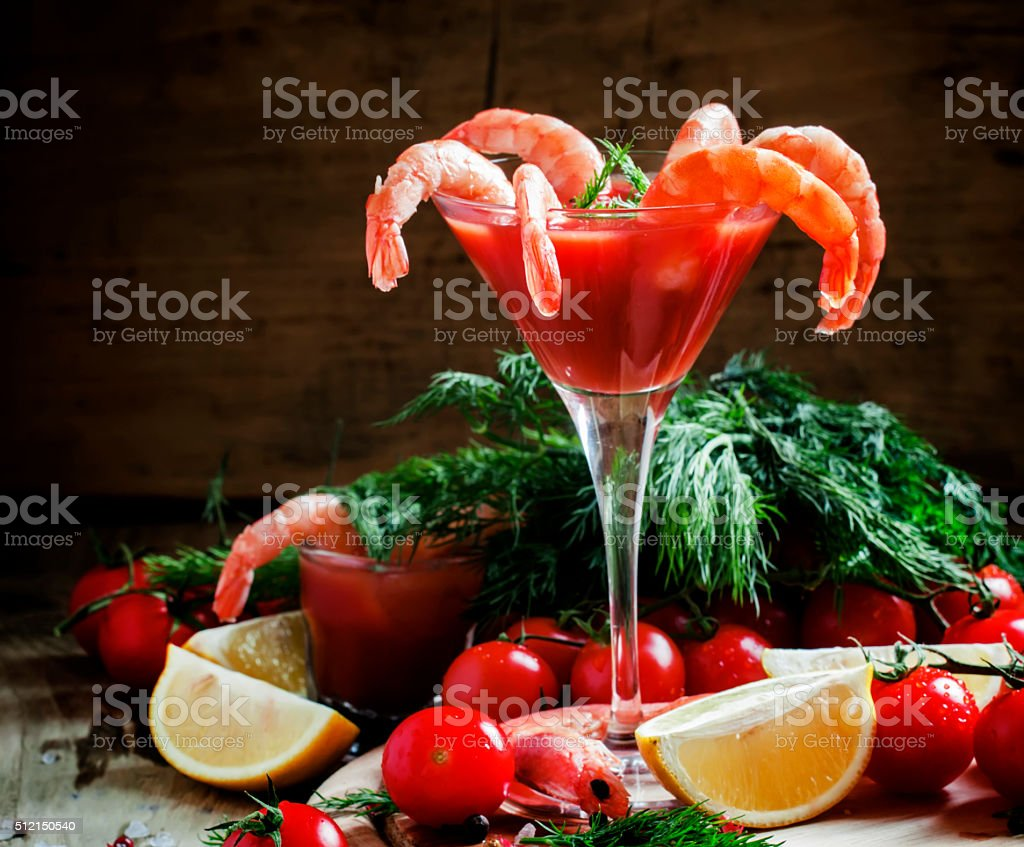 Shrimp cocktail in a martini glass, vegetables, spices stock photo