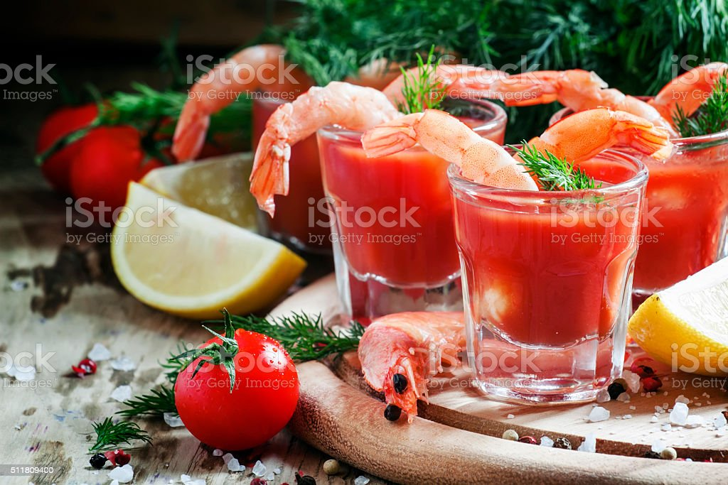 Shrimp cocktail in small glasses, cherry tomatoes stock photo