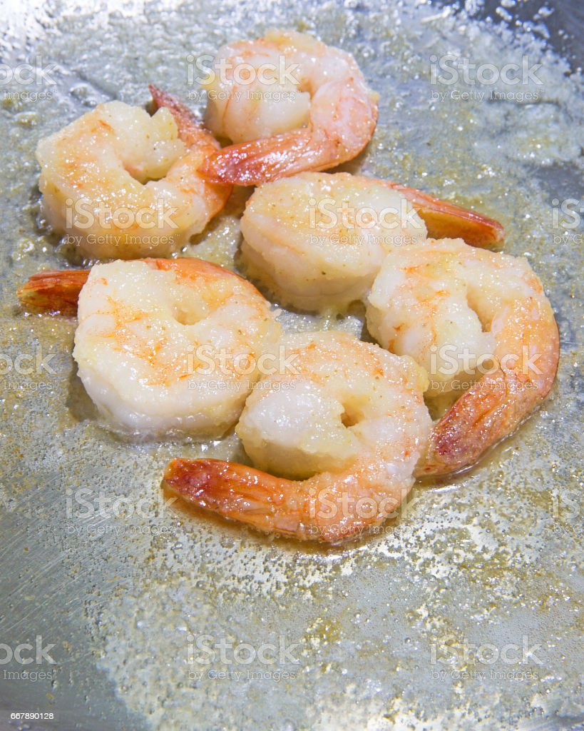 shrimp cooking in butter royalty-free stock photo