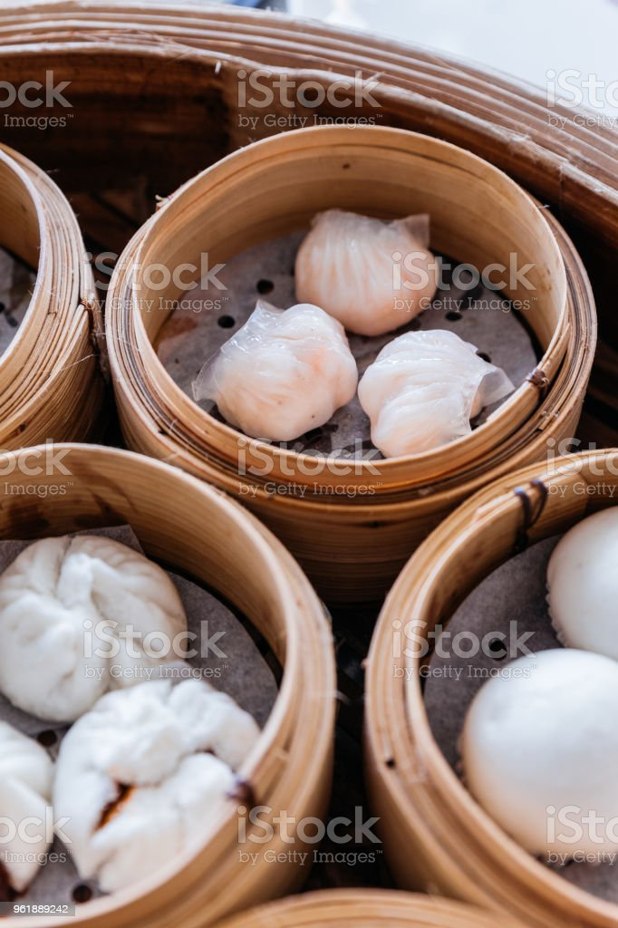 Shrimp dumplings served in steamer baskets with many kind of Dim sum. stock photo