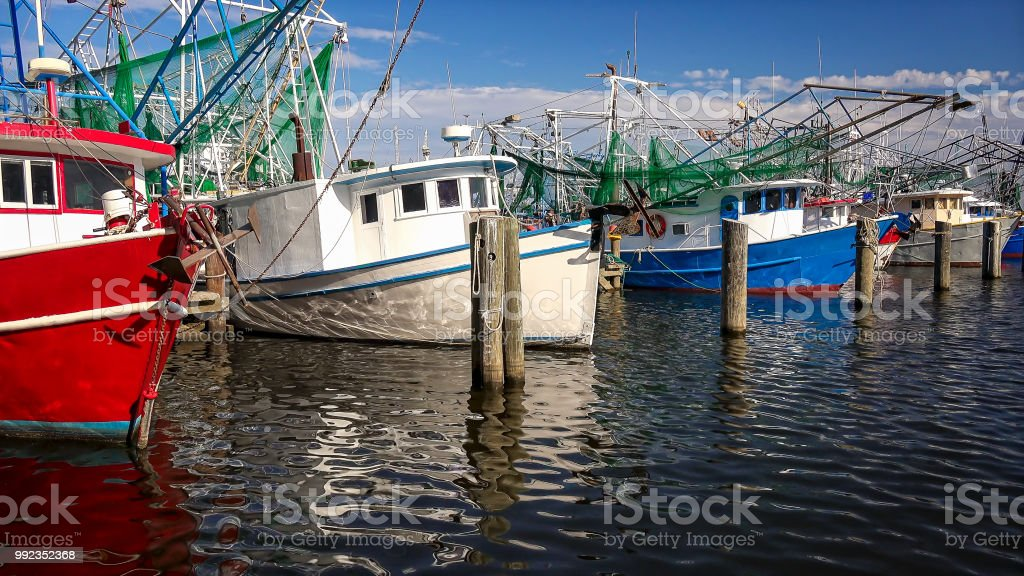 Shrimp Fishing Boats in Harbor in Biloxi, Mississippi stock photo