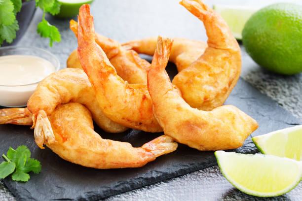 Shrimp fried in batter with sauce. stock photo