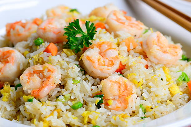Shrimp fried rice delicious shrimp fried rice on a plate fried rice stock pictures, royalty-free photos & images