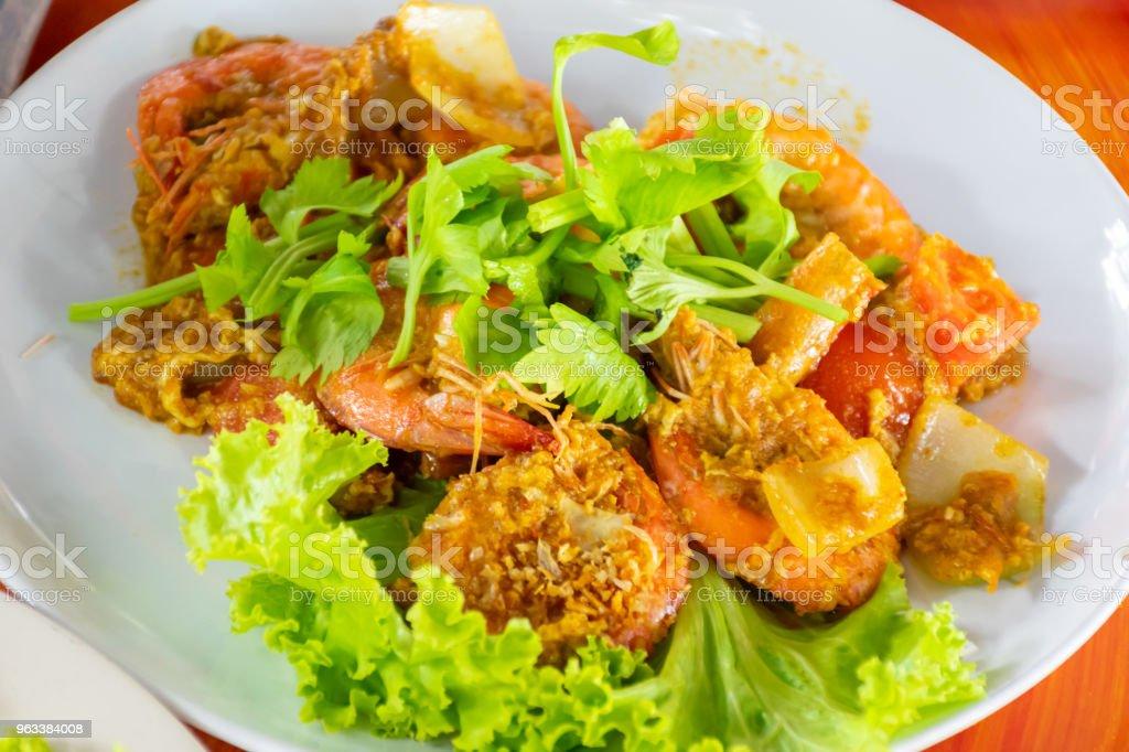 Shrimp grilled fried with curry powder. - Zbiór zdjęć royalty-free (Curry)