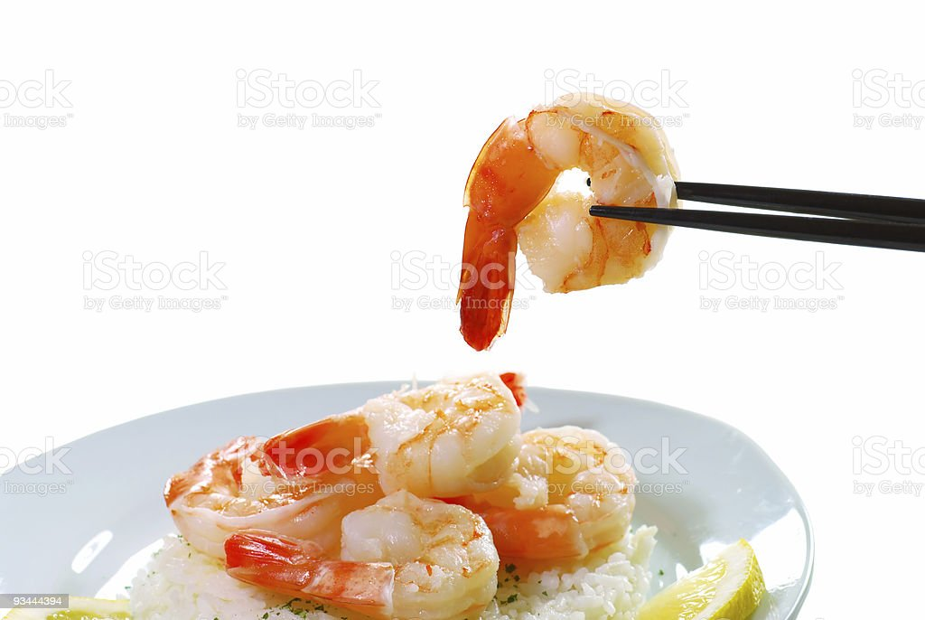 shrimp held by chop sticks royalty-free stock photo