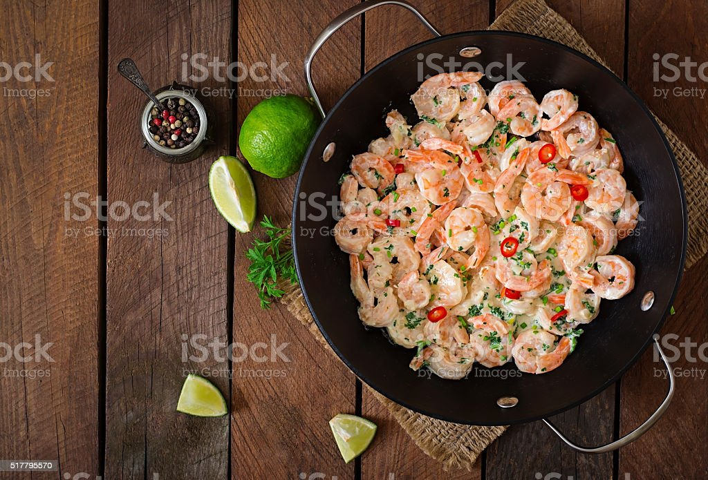 Shrimp in a creamy garlic sauce with parsley stock photo