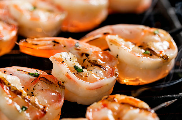 shrimp kebab on the grill - gegrillte garnelen stock-fotos und bilder