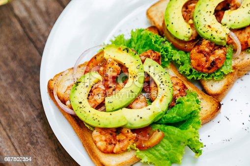 istock Shrimp sandwiches with avocado 667802354