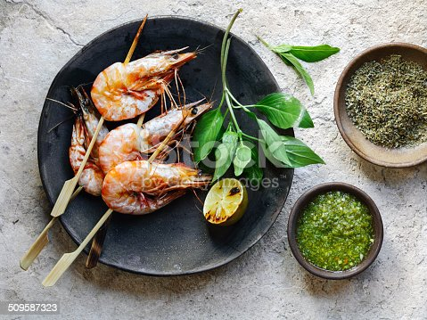 Shrimp satay with garlic sauces and herb