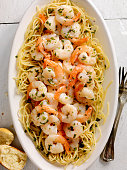 Shrimp Sauteed in a Wine, garlic, butter Sauce, served with Pasta