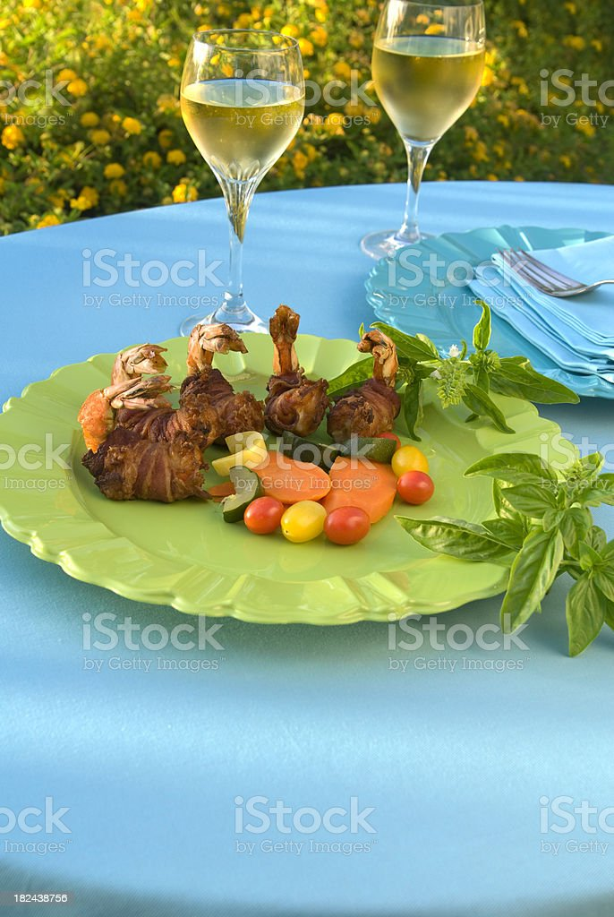 Shrimp Seafood & Wine Dinner & Place Setting on Outdoor Dining Table royalty-free stock photo