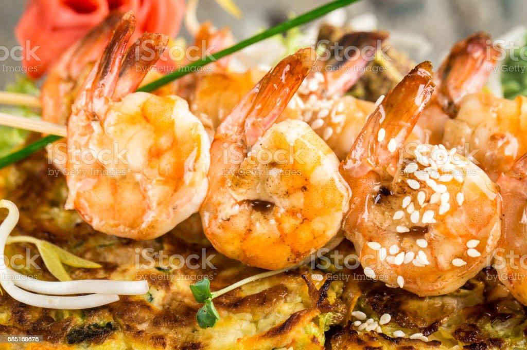 Shrimp skewers on vegetable omelette royalty-free stock photo