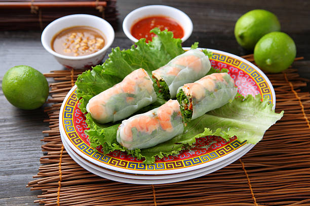 Shrimp Spring Rolls Shrimp Spring Rolls with peanut & spicy dressing vietnamese culture stock pictures, royalty-free photos & images
