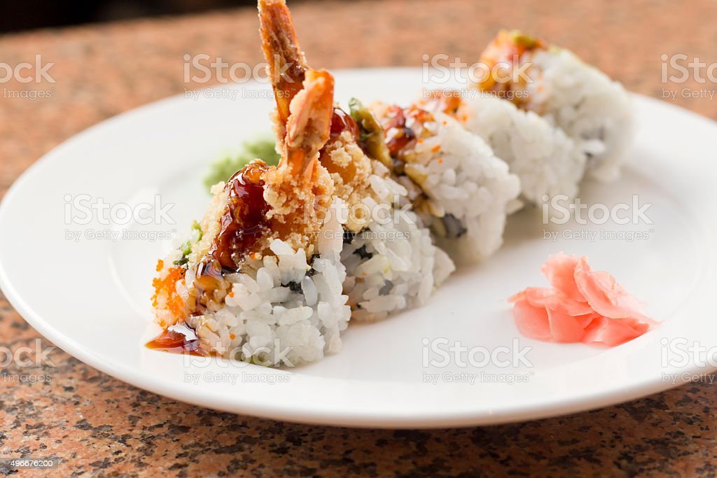 Shrimp Tempura Avocado Sushi Roll stock photo
