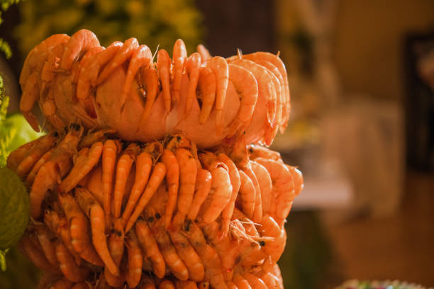 Shrimp tower with table decorated with fruits and cold cakes Shrimp tower with table decorated with fruits and cold cakes reveillon stock pictures, royalty-free photos & images