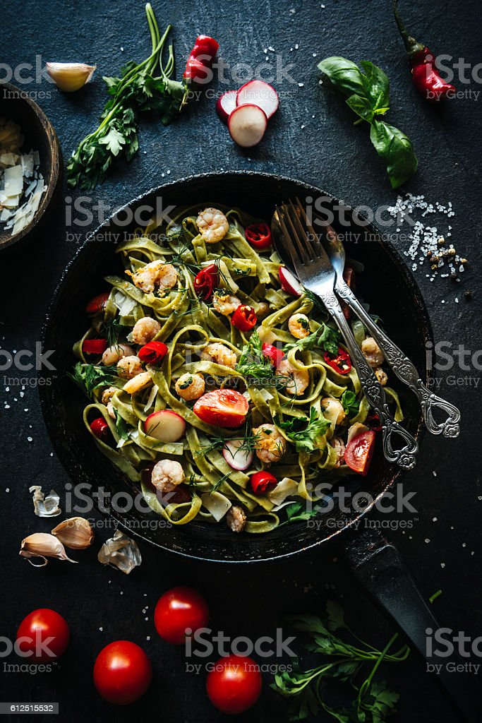 Shrimps and tagliatelle time stock photo