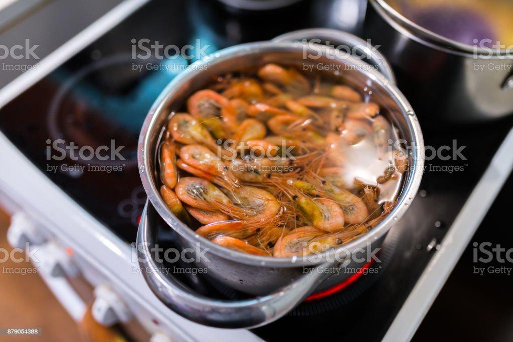 Shrimps boil in pan. stock photo