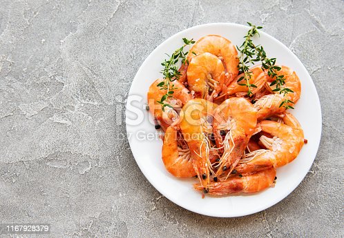 Shrimps in plate on a grey concrete background