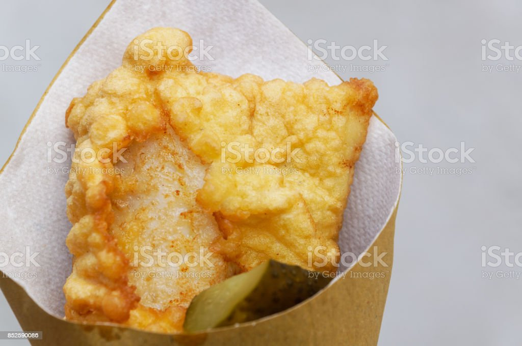 Shrimps, potatoes and vegetables in batter, fried . Street food in cardboard package. stock photo