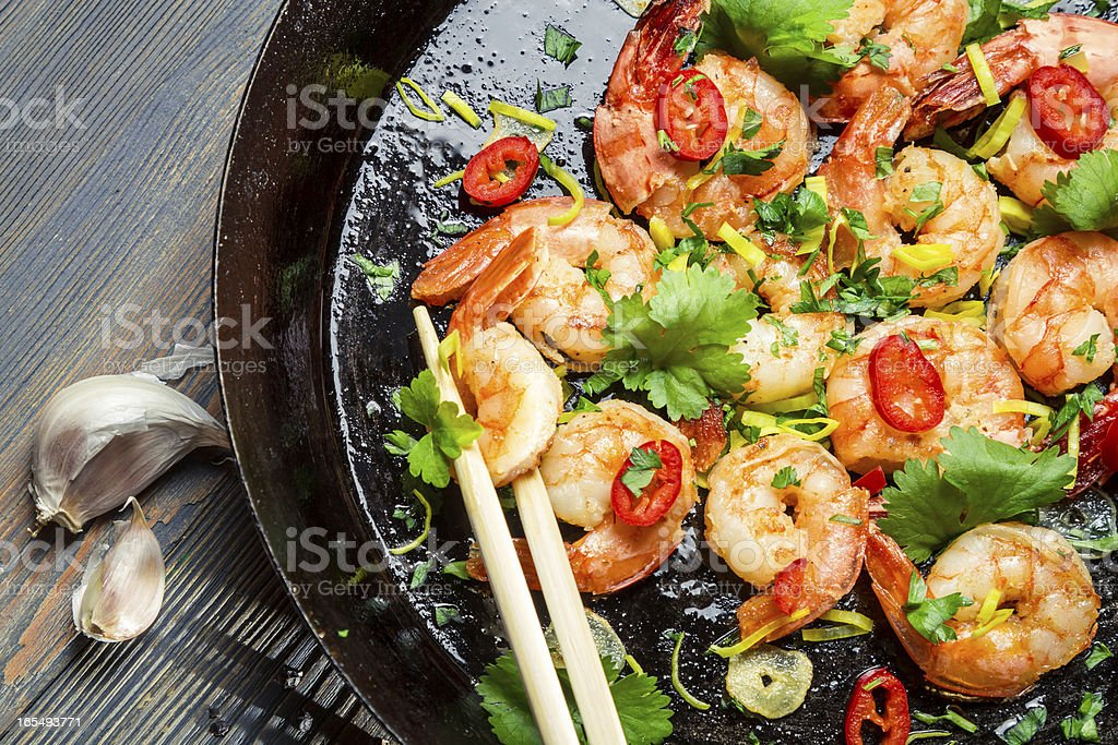 Shrimps sauteed with garlic and butter stock photo