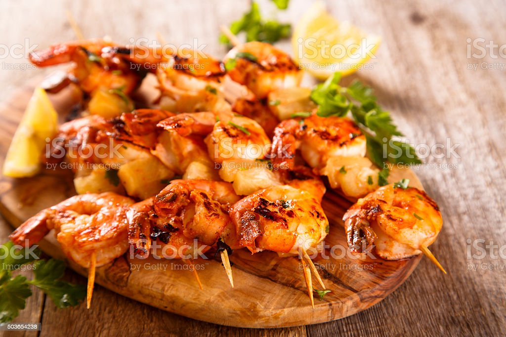 Shrimps skewers stock photo