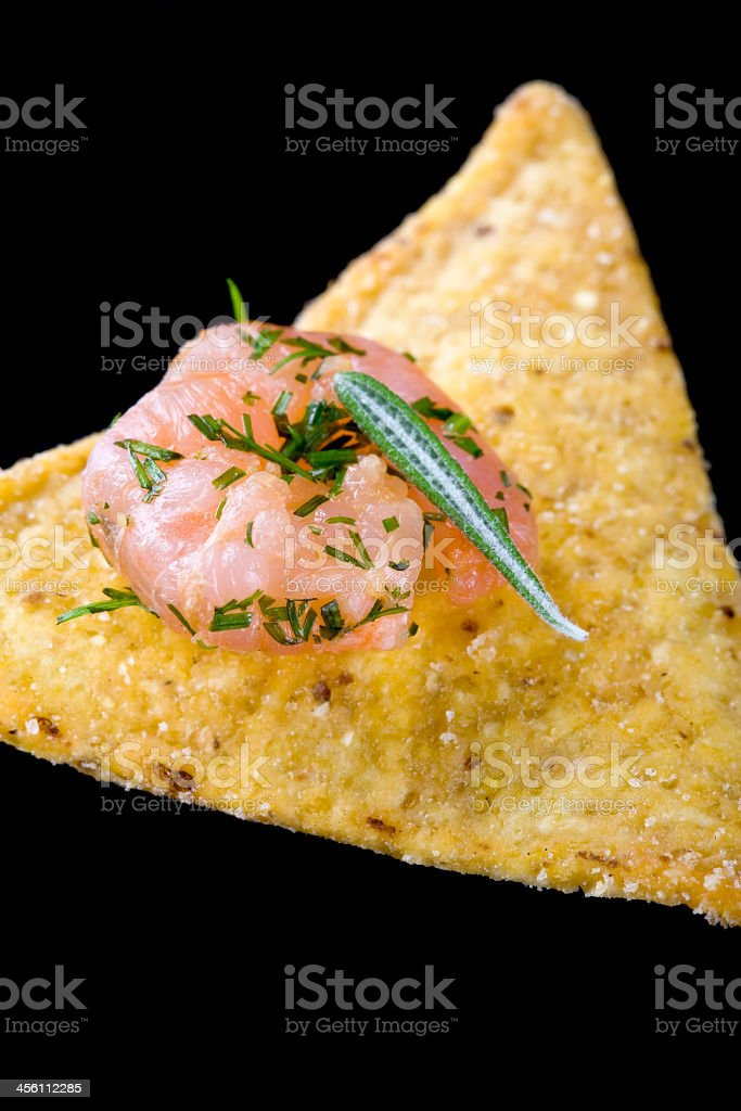 Shrimps with dill and rosemary on tortilla chips stock photo