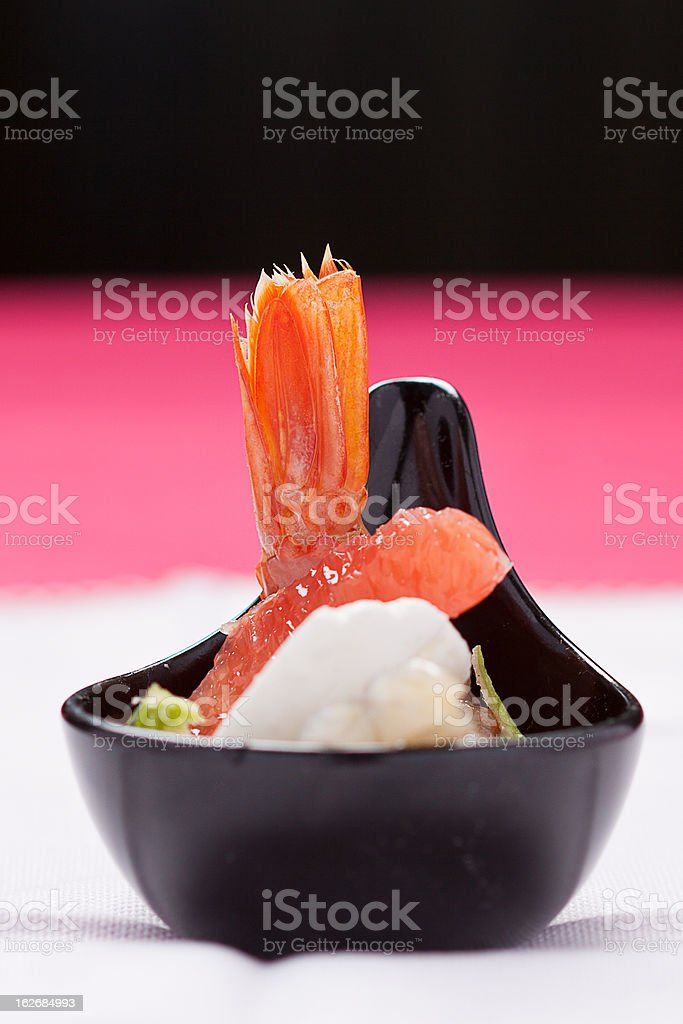 Shrimps with orange (three colors background) stock photo