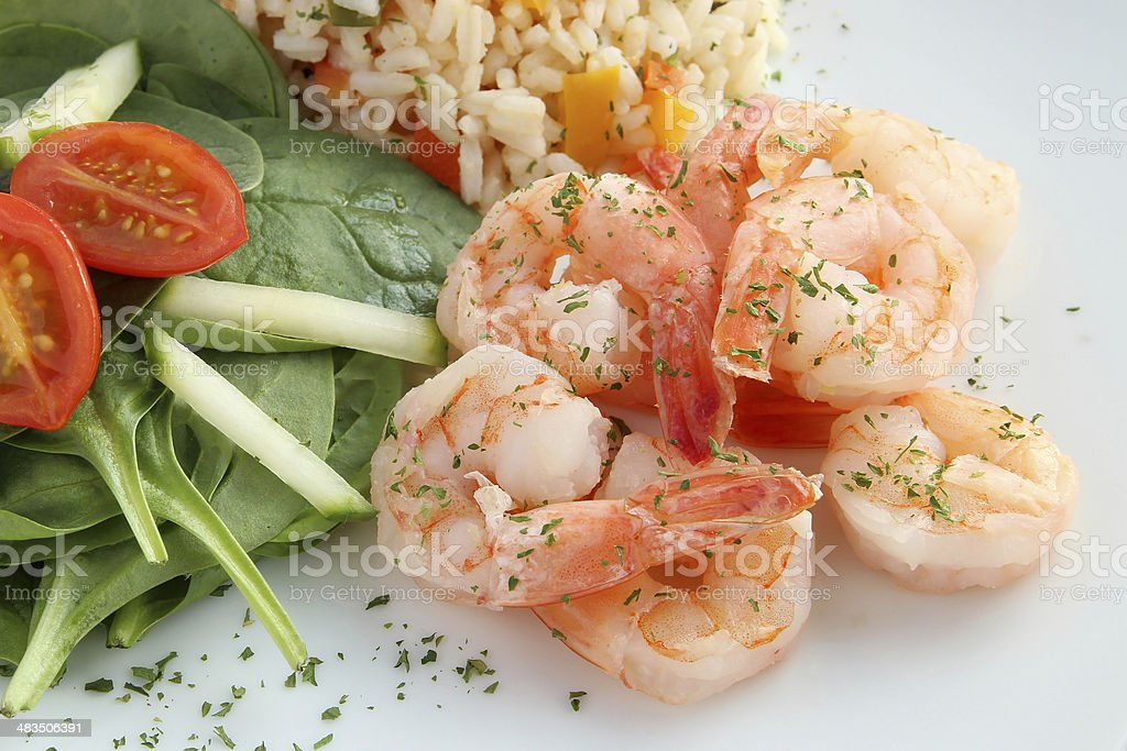 Shrimps with rice and salad stock photo