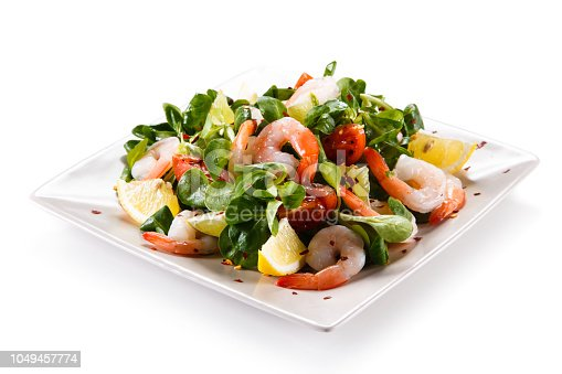 Shrimps with vegetables on white background