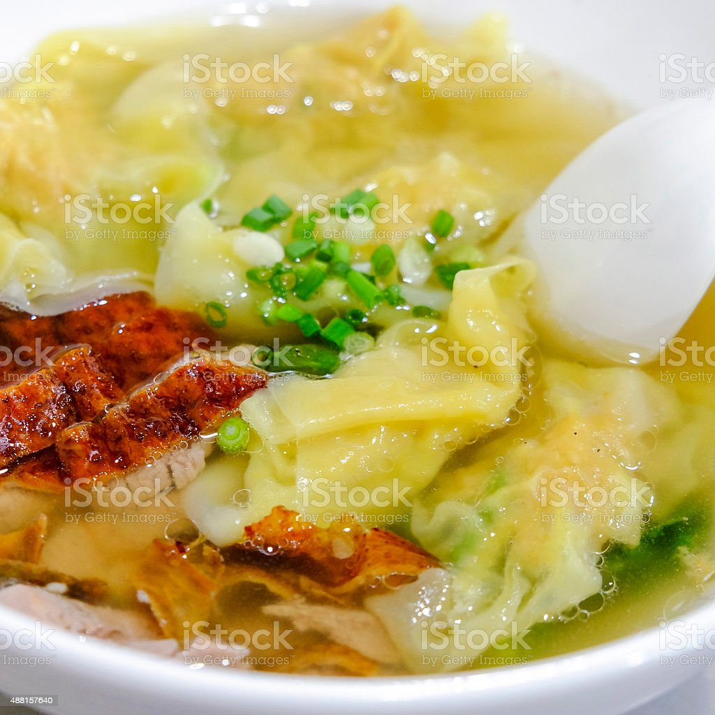 Shrimps wontons served with sliced roast duck stock photo