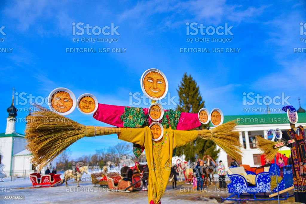 Shrovetide in Russia  -  Maslenitsa festival or Pancake week. Big doll  as symbol the end of winter  and  spring coming stock photo