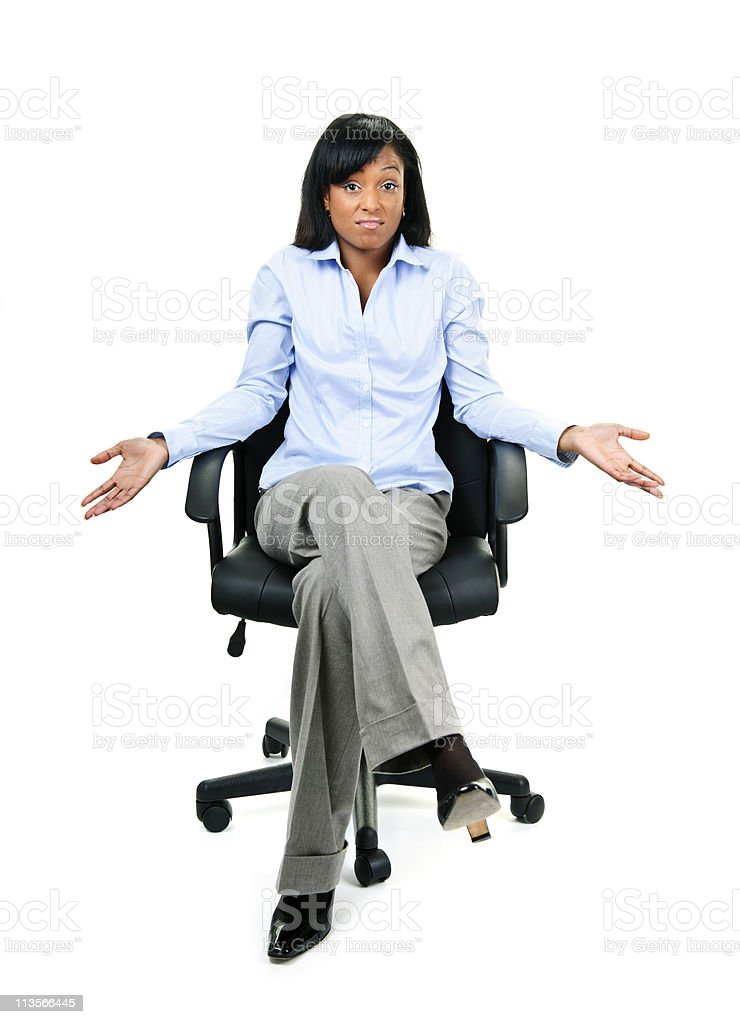 Shrugging businesswoman in office chair royalty-free stock photo