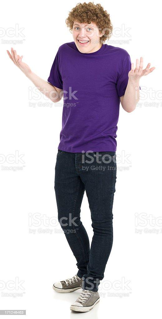 Shrugging Teenage Boy Standing stock photo