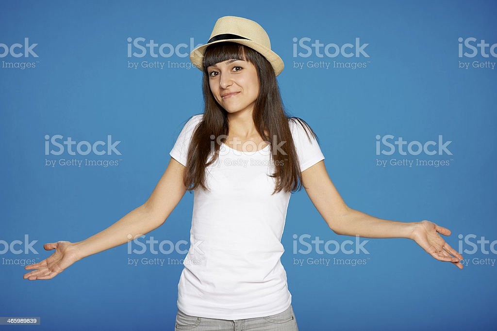 Shrugging woman in doubt royalty-free stock photo