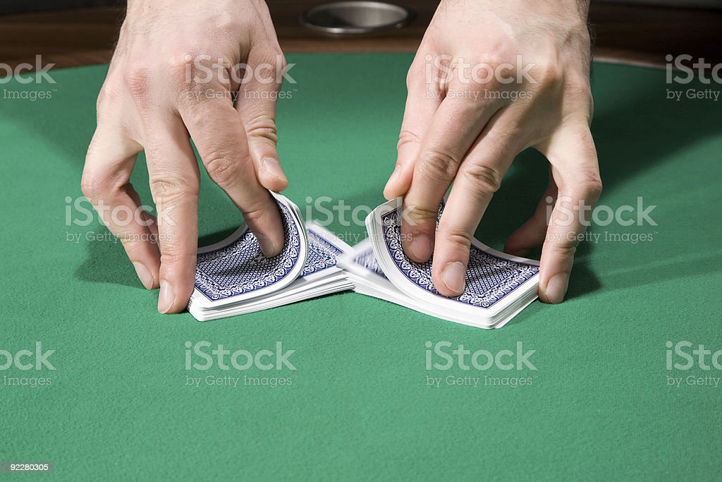 Shuffles and Let the cards hit the felt royalty-free stock photo