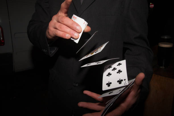 Shuffling Cards A magician shuffling a deck of playing cards magic trick stock pictures, royalty-free photos & images