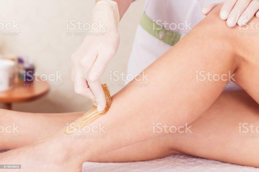 Shugaring. Cosmetic procedure of sugar depilation stock photo