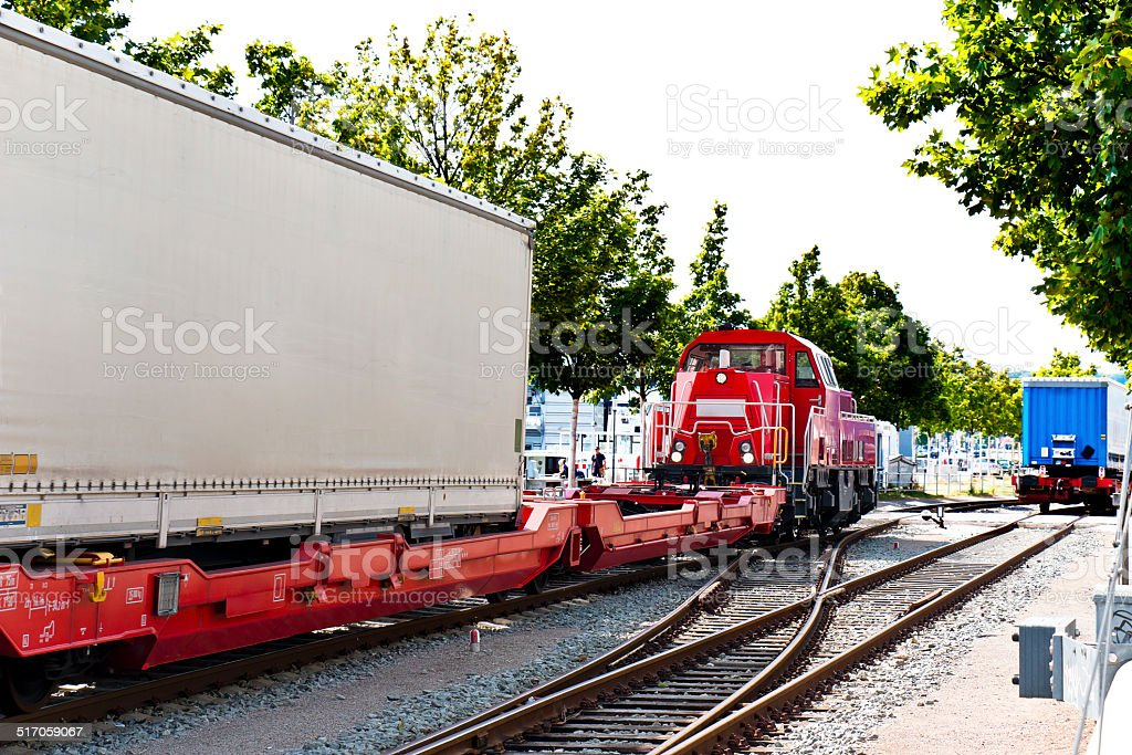 Shunting locomotive pulling container wagon stock photo