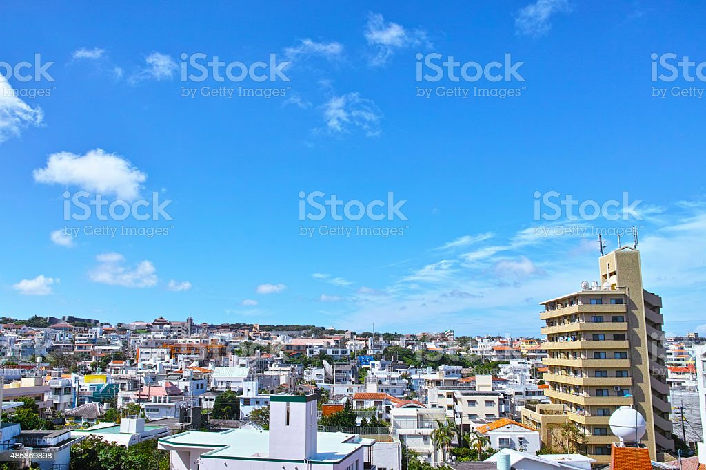 Shuri Castle as seen from Naha residential area stock photo