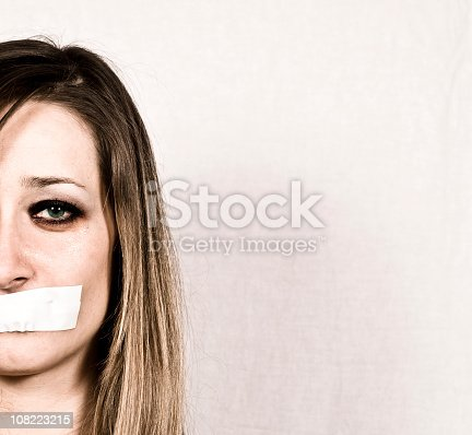 istock Shut up concept of woman with tapes mouth 108223215