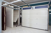 Shutter door or roller door and concrete floor outside .White Automatic shutters in a house . gates in the garage . Automatic Electric Roll-up Gate Or Push-up Door In The Modern Building Ground Floor .