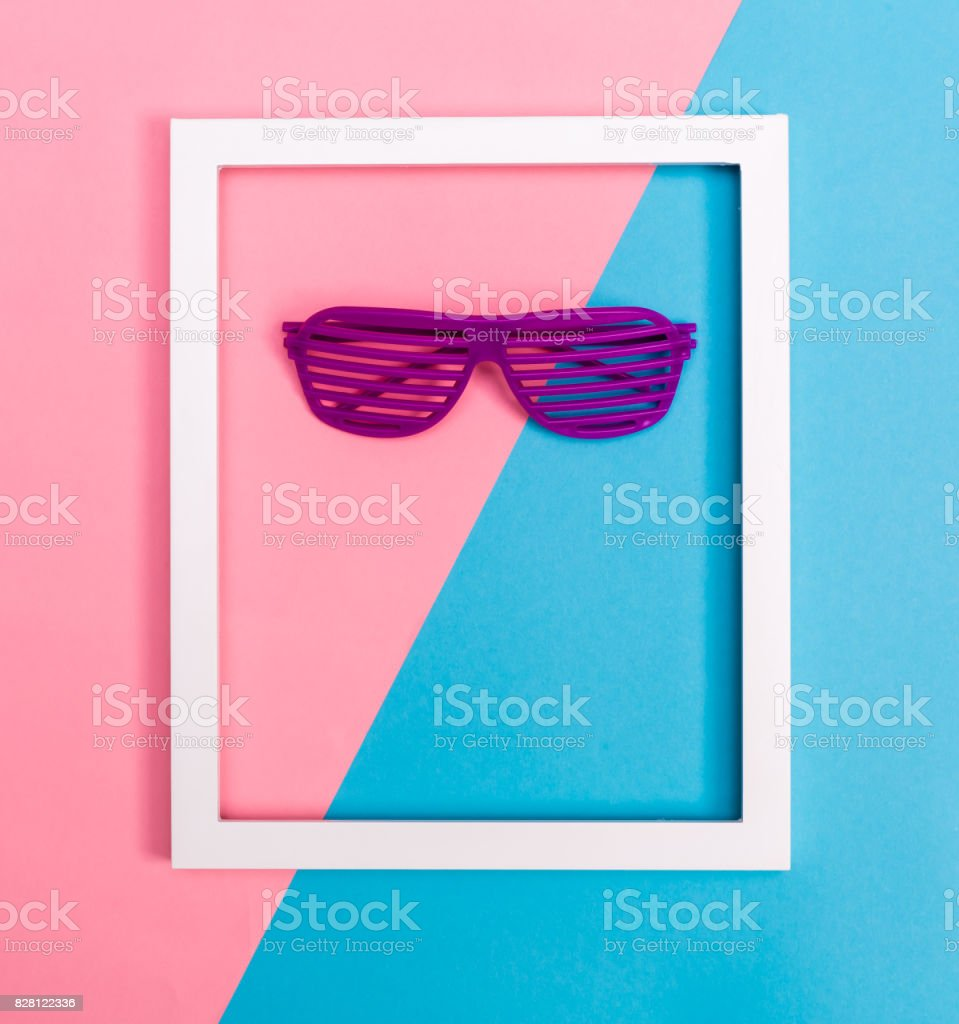 Shutter shades sunglasses on a vibrant background stock photo