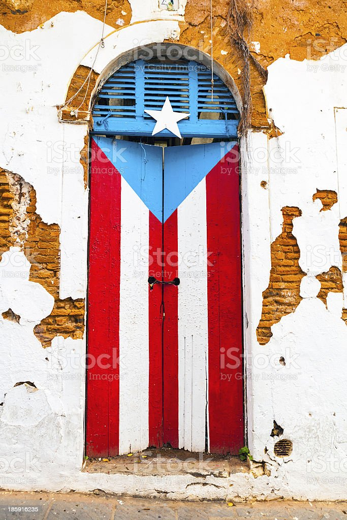 A shuttered window in San Juan painted as the flag stock photo