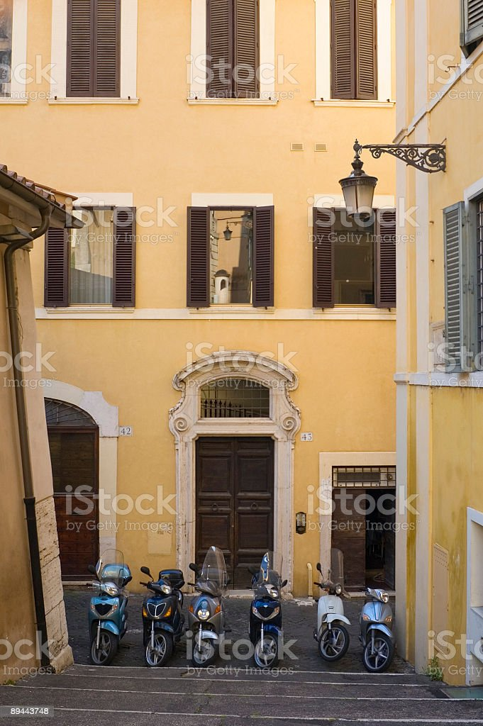 Shutters, scooters and steps royalty-free stock photo