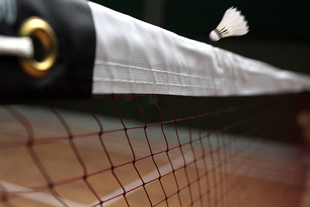 Shuttle badminton net up close and a fast moving shuttlecock stock photo