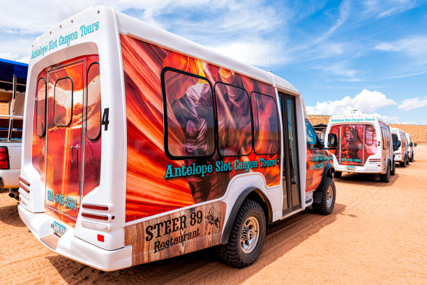 Shuttle buses for Navajo tribal Adventurous photo tours at Upper Antelope slot canyon in Arizona Page, USA - August 10, 2019: Many colorful shuttle buses for Navajo tribal Adventurous photo tours at Upper Antelope slot canyon in Arizona page arizona stock pictures, royalty-free photos & images